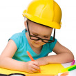 Stock Photo: Cute little girl draw with marker wearing hard hat