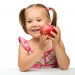 Portrait of a little girl with apple — Stock Photo #7415752