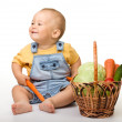 Cute little boy with basket full of vegetables — Stock Photo #7415804