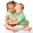 Two children are playing on the floor — Stock Photo #7415826