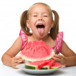 Cute little girl is going to eat watermelon — Stock Photo #7446492