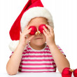 Cute little girl wearing santa hat — Stock Photo
