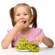 Little girl is eating grapes — Stock Photo #7452586