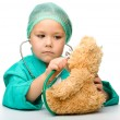 Little girl is playing doctor with stethoscope — Stockfoto