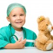 Little girl is playing doctor with syringe — Stock Photo