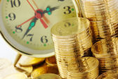 Time is money - clock dial and golden coins — 图库照片