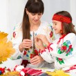 Mother and child in Ukrainian national cloth — Stock Photo