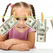 Cute little girl with paper money - dollars — Stok fotoğraf