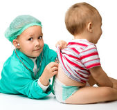 Children are playing doctor with stethoscope — Стоковое фото