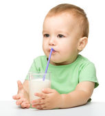 Cute little boy is drinking milk — Stock Photo
