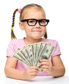 Cute little girl with paper money - dollars — Stock Photo