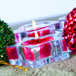 Christmas baubles and candles — Stock Photo