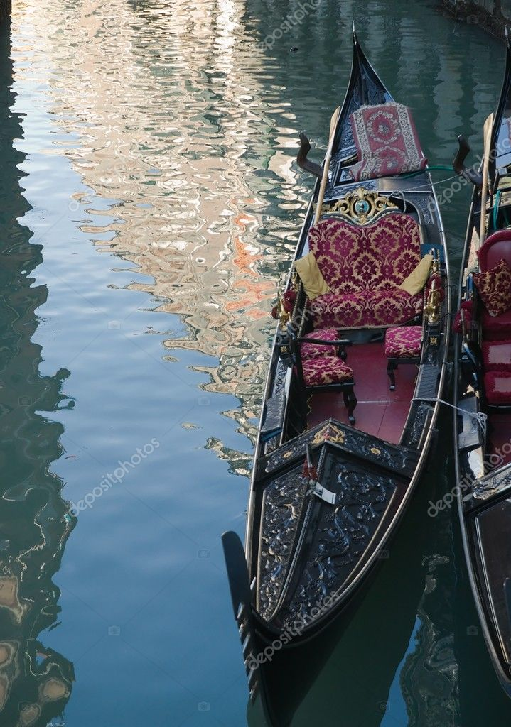 Venetian gondola and reflections in a channel  Lizenzfreies Foto #6937038