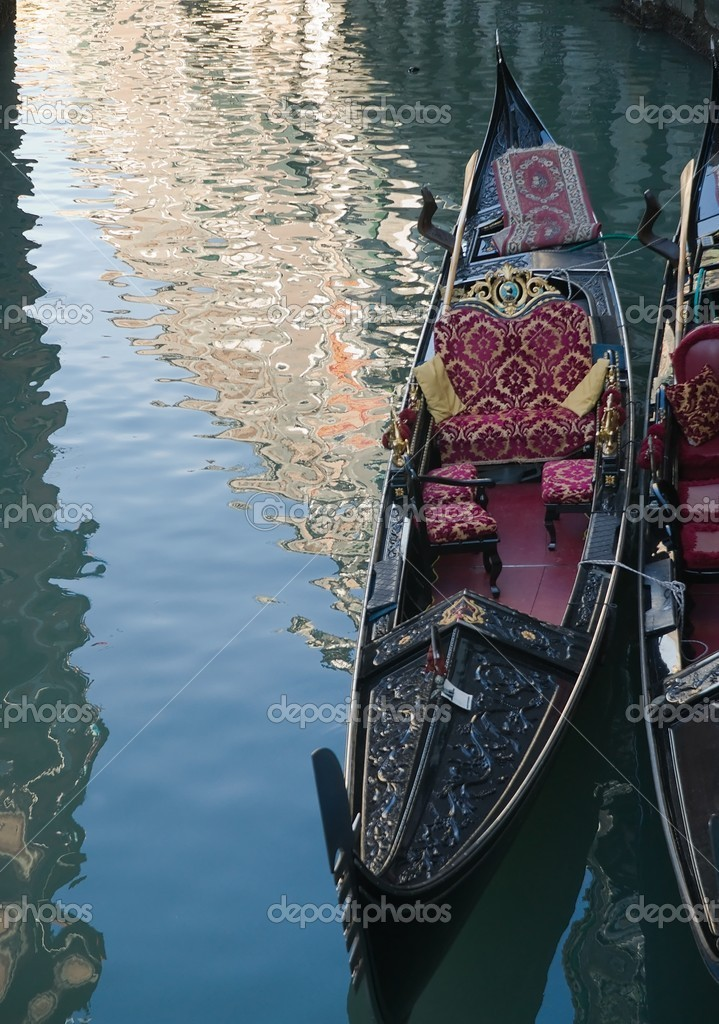 Venetian gondola and reflections in a channel — Foto de Stock   #6937038