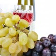 Bottle of wine with glasses of wine and grapes isolated in white — Stock Photo