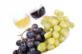 Glasses of wine with grapes isolated in white — Stock Photo