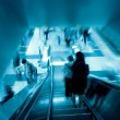Passenger on moving escalator — Stock Photo #6918044