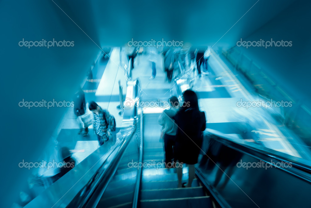 Passenger on moving escalator in Guangzhou subway station  Stock Photo #6918044