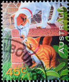 AUSTRALIA stamp shows dag and cat — Stock Photo