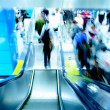 Passenger on moving escalator — Stock Photo #7109470
