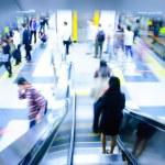 Passenger on moving escalator — Stock Photo
