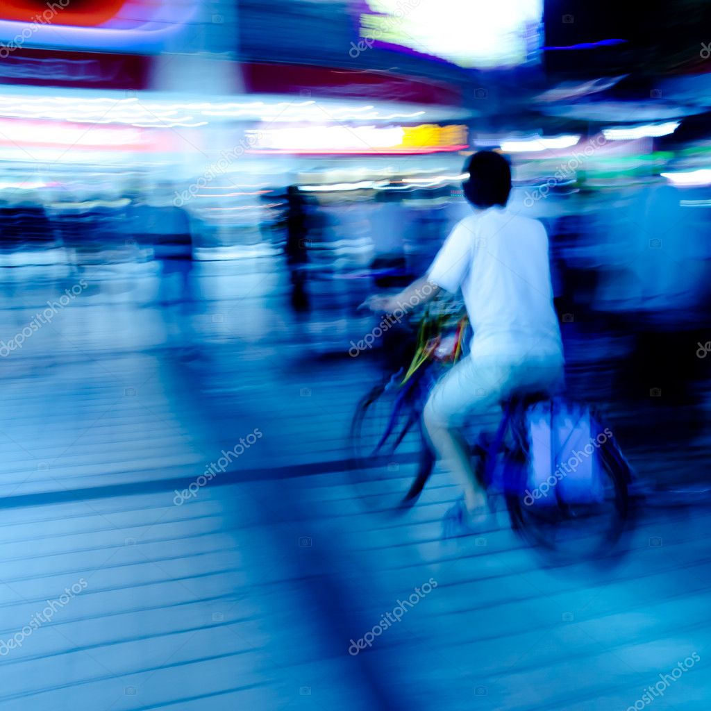 City on bicycle blur motion — Stock Photo #7108992