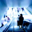 Passenger on moving escalator — Stock Photo #7223454
