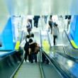 Stock Photo: Passenger on moving escalator