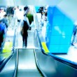Passenger on moving escalator — Stock Photo