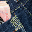 Jeans, cell phone and cash — Stock Photo