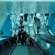 Passenger on moving escalator — Stock Photo #7304056