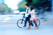 Leisurely boy and girl walk with bicycle — Stock Photo