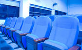 Blue chairs in conference room — Stock Photo