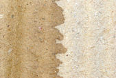 Dry and wet brown corrugate cardboard texture — Foto Stock