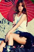 Woman portrait with parasol — Stock Photo