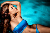Bikini woman by the pool — Stock Photo