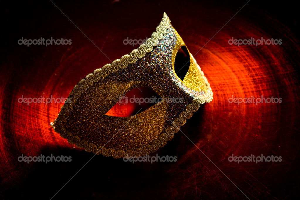 Carnival mask on dark  red background  Stock Photo #7919138