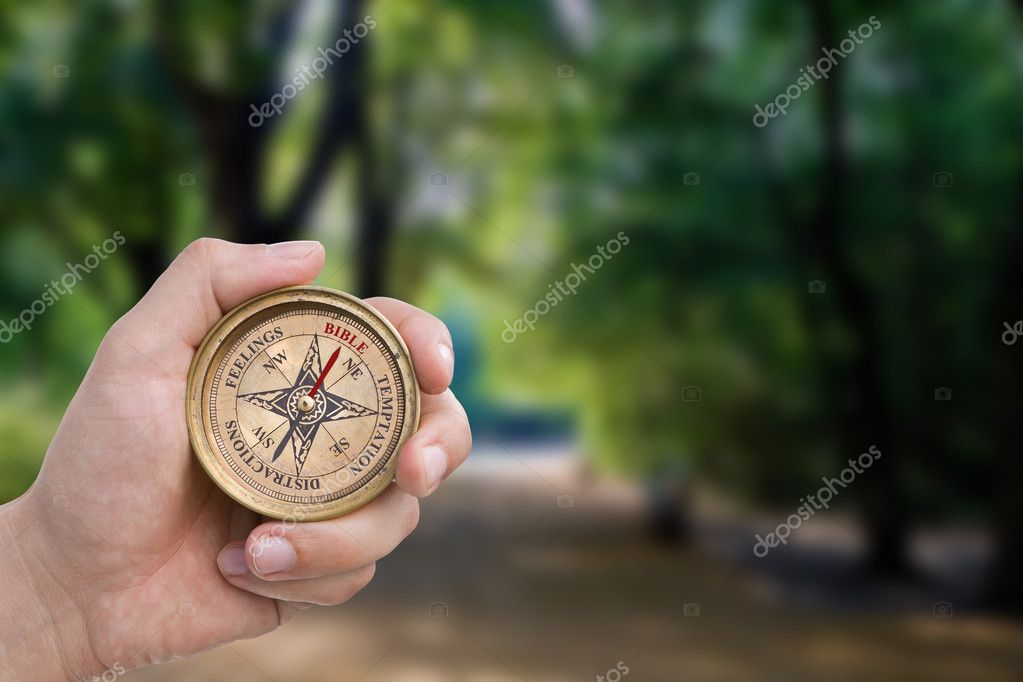Bible, temptation, distractions, feelings compass. Includes clipping path.  Stock Photo #7540725