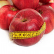 Red apple and measuring tape isolated on white — Stock Photo #7556671