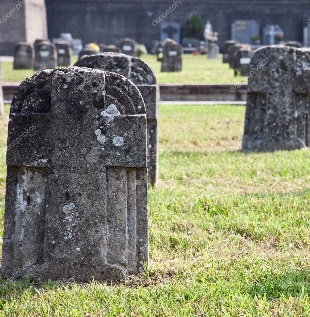 Many graves made of stone on the grass. — Stock Photo #6825396