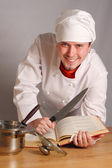 The cook with a knife — Stock Photo