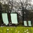 Deck chairs in a park — Stock Photo #6777044