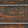 Metal frame on brick wall — Stock Photo #6777102