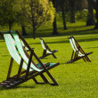 Deck chairs in a park — Stock Photo #6777123