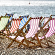 Deckchairs on Brighton beach — Stock Photo #6777158