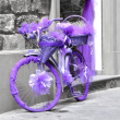 Stock Photo: A bicycle wrapped in purple fabric