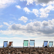 ligstoelen op brighton beach — Stockfoto