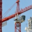 Stock Photo: Cranes on construction site