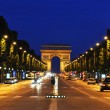 The Champs-Elysees at night, Paris - Stock Photo