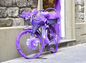 A bicycle wrapped in purple fabric — Stock Photo